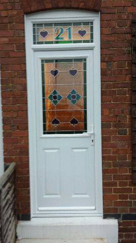 upvc-glass-decorative-door-matching-top-glass